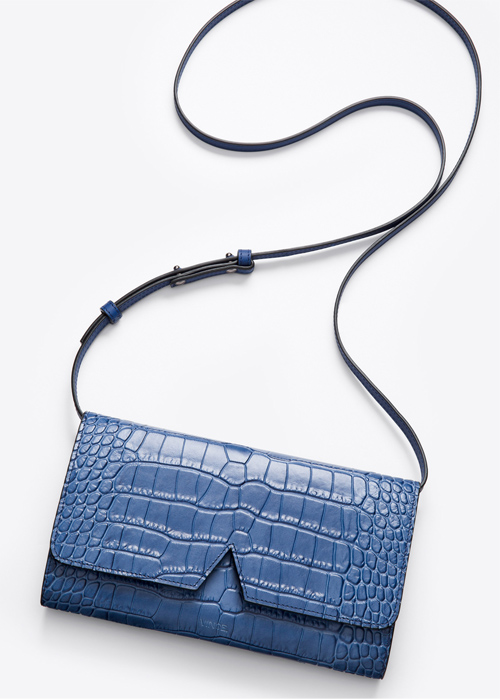 Signature collection stamped croc baby crossbody in cobalt, $265, available at VINCE