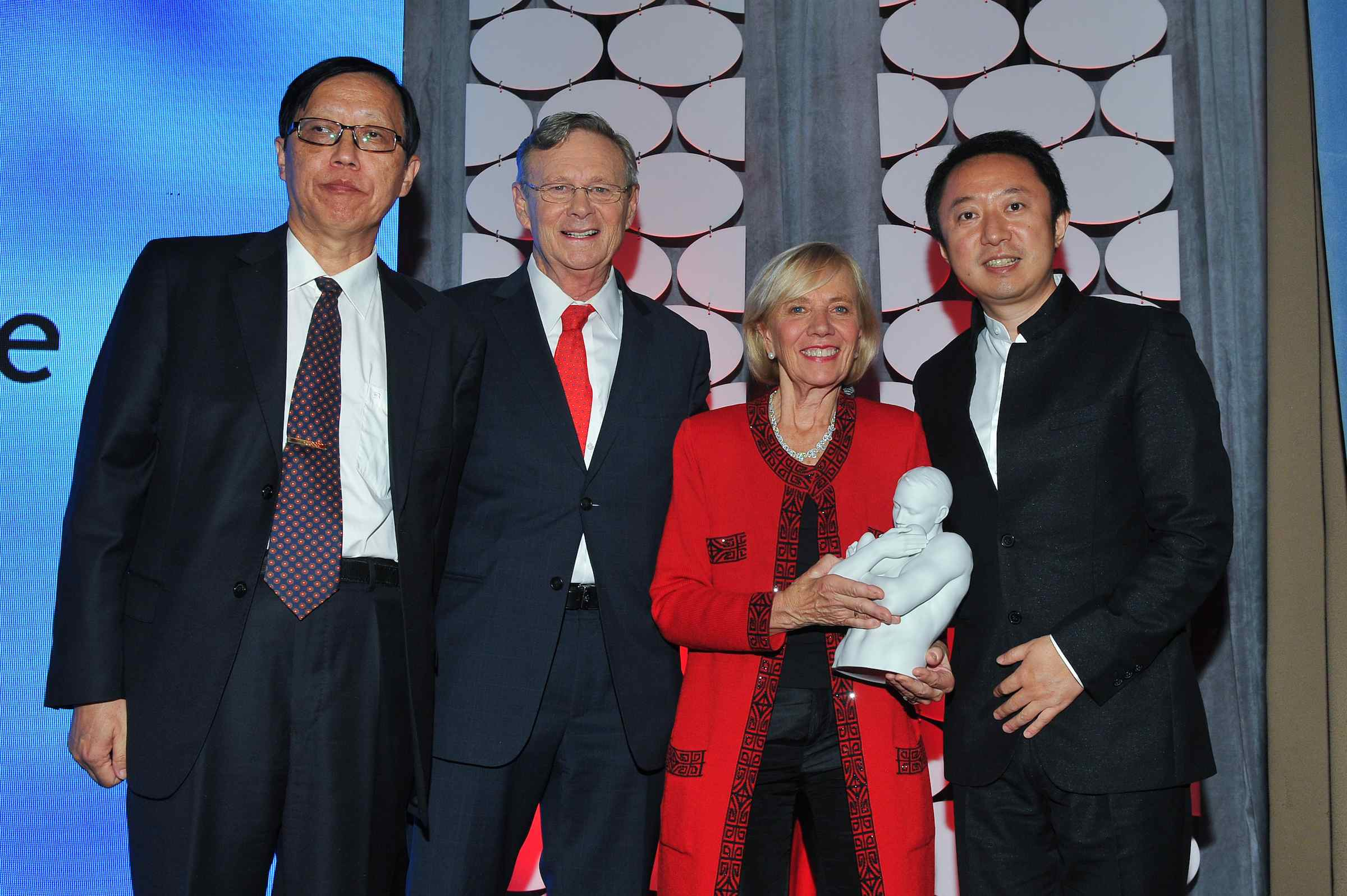 Mr Wang Lin (Chairman and Secretary of CCAFC), Dr. Bill and Kathy Mcgee ( Operation Smile Co-Founders), Mr. Li Ya (President of Ifeng.com)